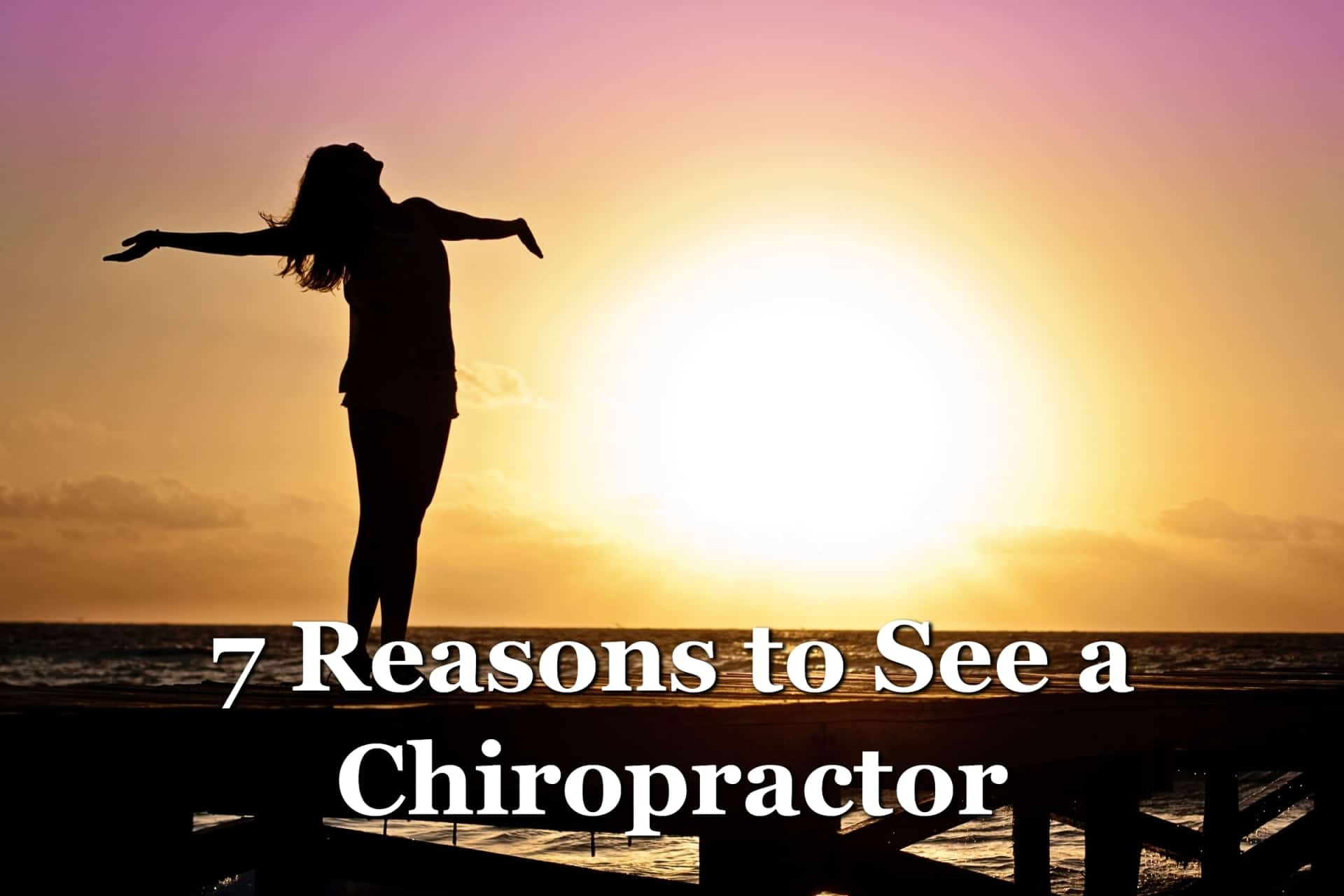 A woman at sunset happy with her reasons to see a chiropractor and eliminate her pain.