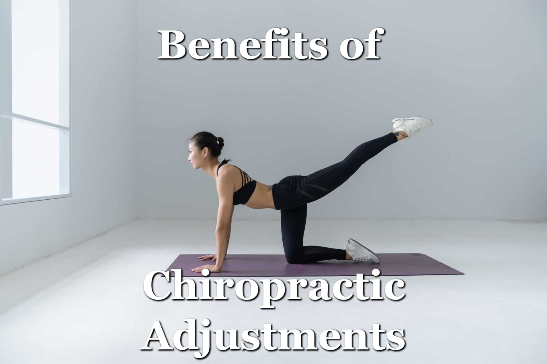 A woman doing yoga after enjoying the benefits of chiropractic adjustments including better mobility