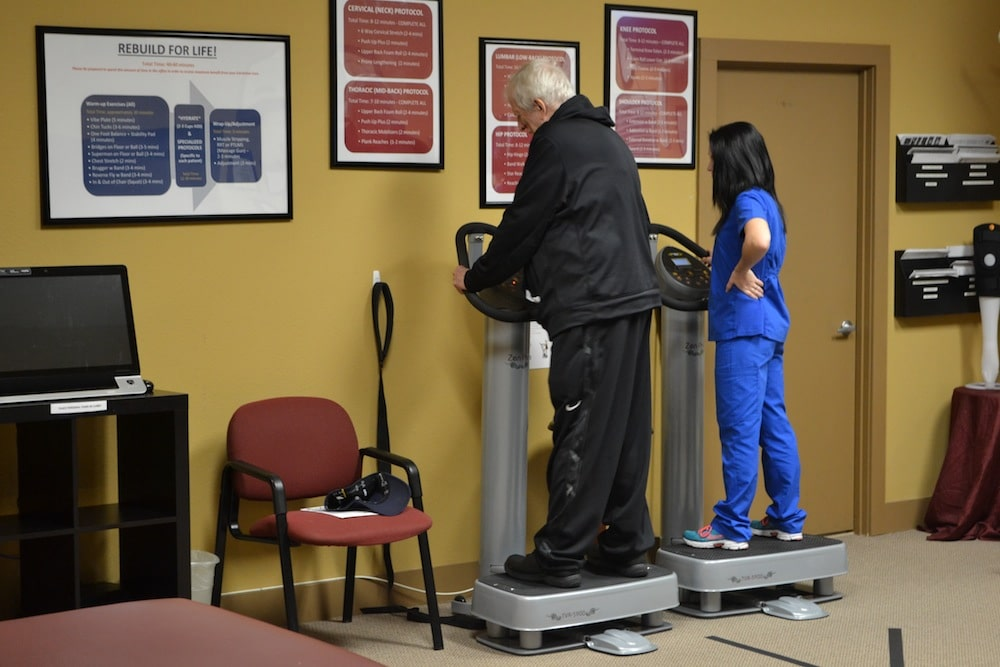 Image of One of the Staff at Freedom Health Centers of McKinney Texas Working on Physical Therapy with a Male Patient